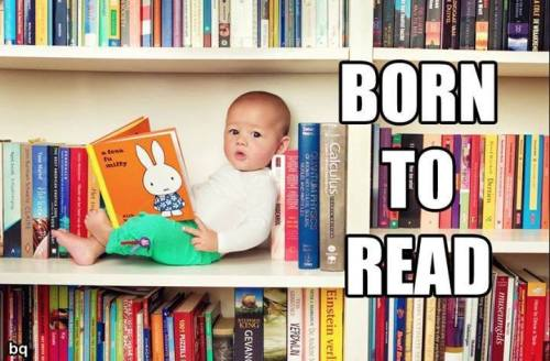 Baby with a bunch of books